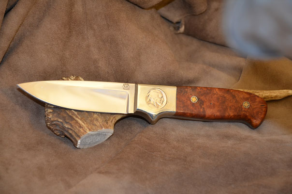 "#165 fFull tang drop point.  Blade length 4 1/2"" Overall 9 5/8"" 440c steel.  Birdseye Maple Burl with nickel siflver bolster with inlayed Indian Head Nickel on one side.  Maker RD Nolen  $400"