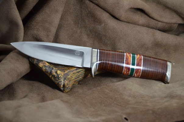 """#184 Narrow tang drop point.  Blade length 4 1/2"""" Overall 9"""" Made with 440C.  Leather spacers with red coral and malachite with aluminum guard and buttcap handle.  Maker RD Nolen $350"""