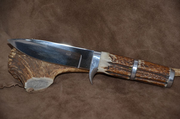 """#72 Drop point .  Blade length 4 1/2"""" Overall 8 7/8"""" 440c steel  Handle stag horn.  Aluminum guard and buttcap spacer.  Maker RD Nolen  $275"""