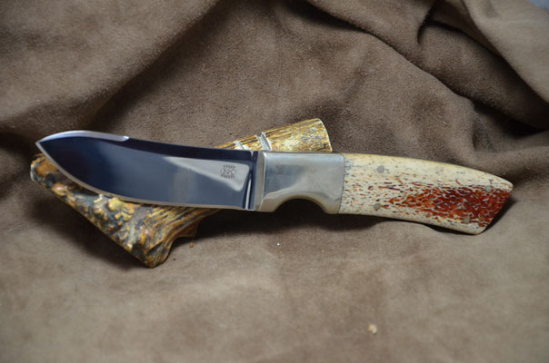 """#231 Green River Skinner.  Blade length 4"""" Overall 8 7/8"""" Made with 440C.  Red Dyed Osic with nickel silver bolsters.  Maker RD Nolen $275"""