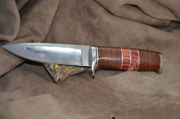 "#183 Narrow tang drop point.  Blade length 5"" Overall 9 3/8"".  Made with 440C.  Handle leather spacers with red corral.  Nickel silver guard and buttcap.  Maker RD Nolen $350"