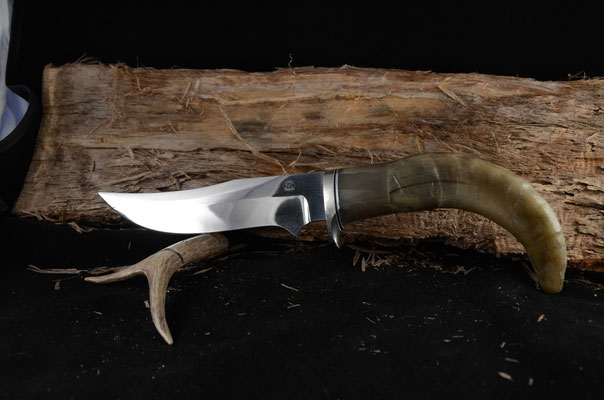 "#98 Double edge clip point.  Blade length 6"" Overall 11 1/4"" 440c steel.  Handle sheep horn with kudo spacer.  Nickel silver guard.  Maker RD Nolen"
