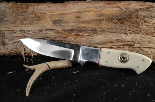 """#85 Full tang drop point.  Blade length 5"""" Overall 10"""".  440c steel  Handle imitation ivory with cowboy star on both sides.  Nickel silver bolster.  Maker RD Nolen $400"""