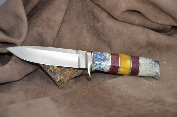 """#189 Narrow tang drop point.  Blade length 4 5/8"""" Overall 9 1/2"""" Made with 440C.  Blue dyed osic with red corral, aluminum guard and buttcap handle.  Maker RD Nolen $450"""