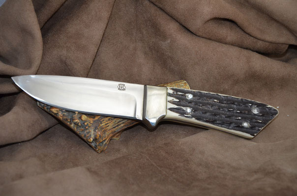 "#191 Full tang drop point.  Blade length 4 1/2"" Overall 9 1/2"" Made with 440C.  Jig bone horn with nickel silver bolsters handle.  Maker RD Nolen $275"