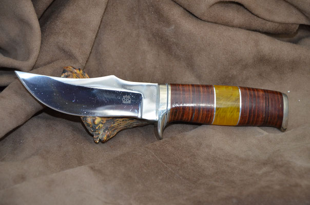 """#186 Nolen hunter.  Blade length 4 5/8"""" Overall 9 1/8"""" Made with 440C.  Leather spacers with amber with nickel silver guard and buttcap handle. Maker RD Nolen $350"""
