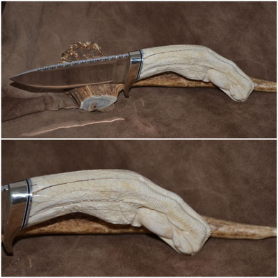 """#149 Drop point with file work.  Blade length 4 1/2' Overall 10"""" 440c steel.  Handle carved eagle claw with egg  - Wart Hog Tusk.  Nickle silver guard $475"""