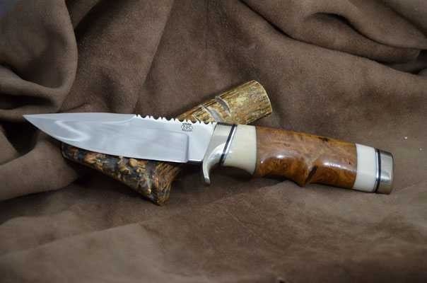 """#193 Narrow tang double edge clip point.  Blade length 4 1/2"""" Overall 9 1/8"""" Made with 440C.  Birdseye maple burl with white corrion with nickel silver guard and buttcap handle.  Maker RD Nolen $375"""