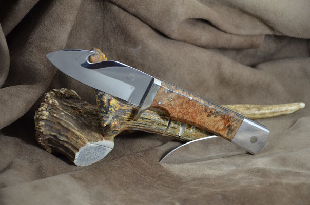 "#182 Kangaroo gut hook.  Gut hook blade 3 1/2"".  Pocket knife blade length 2 3/4"".  Overall when open 11"" Overall when closed 8 1/8"".  Stabilized birdseye maple burl with nickel silver guard with aluminum bolster on pocket knife.  Maker RD Nolen  $500"