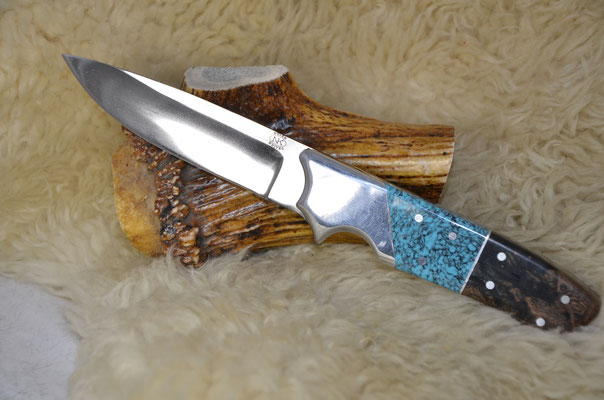 #55 Full tang utility knife.  Blade length 4 1/4 Overall 9 1/2 440c steel.  Handle turquoise.  Stabilized boco wood.  Aluminum bolster.  Maker RD Nolen  $300