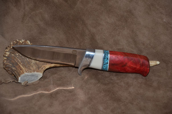 """#143  Drop Point.  Blade length 4 1/2""""  Overall 8 5/8""""  440c steel  Handle stabilized red maple burl with white corion and turquoise spacers.  Aluminum guard.  Maker RD Nolen  $300"""