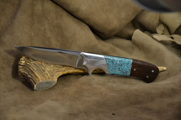 """#154 Full tang drop point.  Blade length 4 3/8"""" Overall 9 5/8"""". Made with 440C. Man made turquoise and cocobolo and aluminum bolster handle.  Made with RD Nolen  $300"""
