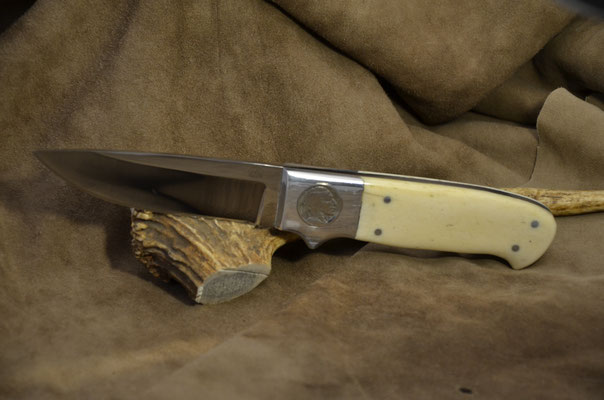 """#158 Full tang Drop Point.  Blade length 4 1/2"""" Overall 9 3/4"""" Made with 440C.  Handle giraffe bone with nickel silver bolsters with inlayed Indian Head nickel and buffalo head nickel.  Maker RD Nolen  $400"""