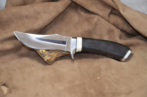 "#232 Nolen hunter.  Blade length 4 3/4"" Overall 10"" Made with 440C.  Buffalo horn with white corrion with aluminum guard and buttcap handle.  Maker RD Nolen $350"