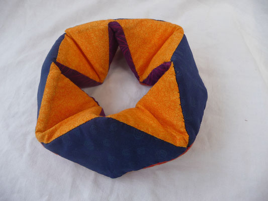We called this a Tetraflexagon. Sewed with 8 Tetrahedrons inside.