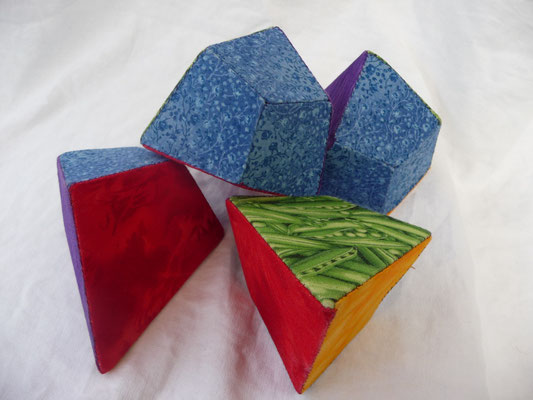 the tetrahedron is divided in 4 puzzle pieces with a blue cut surfaces on each puzzle piece.