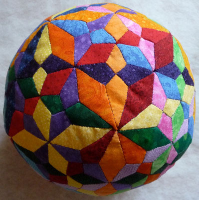 Spheres with different tiling in the surface