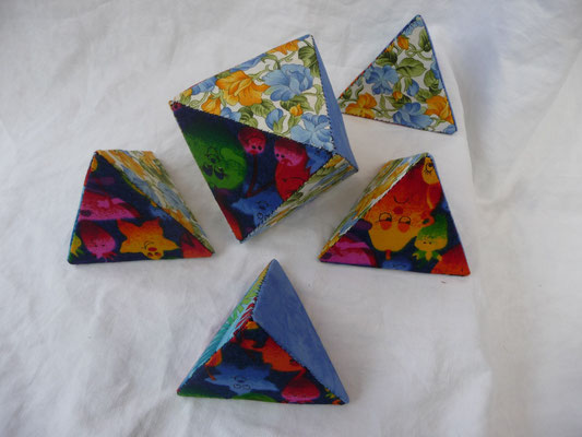 Next cube is with a pentagon symbol in a floral print = the tetrahedron is divided in 5 puzzle pieces with a floral print on the cut surfaces on each puzzle piece. Here I have one octahedron and 4 little tetrahedron.