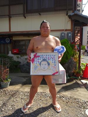 お相撲さんに贈る、熱烈ファン似顔絵ボード。