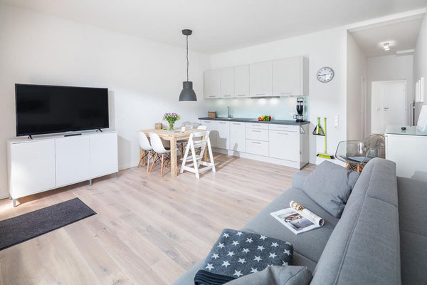 Ferienwohnung Norderney Esszimmer und Wohnbereich im Loft A im Strandloft 2 © norderney.top - Ferienwohnungen auf Norderney