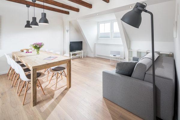 Ferienwohnung Norderney Esszimmer und Wohnbereich im Loft E im Strandloft 2 © norderney.top - Ferienwohnungen auf Norderney