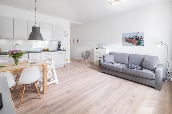 Ferienwohnung Norderney Esszimmer und Wohnbereich Loft A im Strandloft 2 © norderney.top - Ferienwohnungen auf Norderney