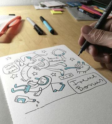 Frank Schulz zeichnet das Motiv Treuebonus ins Skizzenbuch