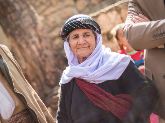 Woman responsible for the baptizing in the Yazidi sanctuary in Lalish, Kurdistan/Iraq. March 2017.