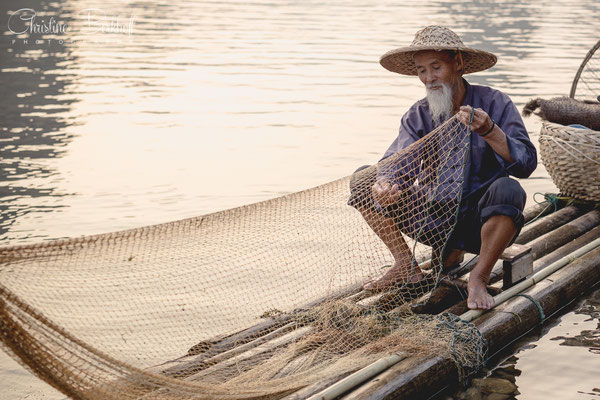 Fisherman in Xingping