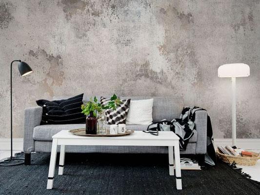 papier peint à effet béton dernière un canapé