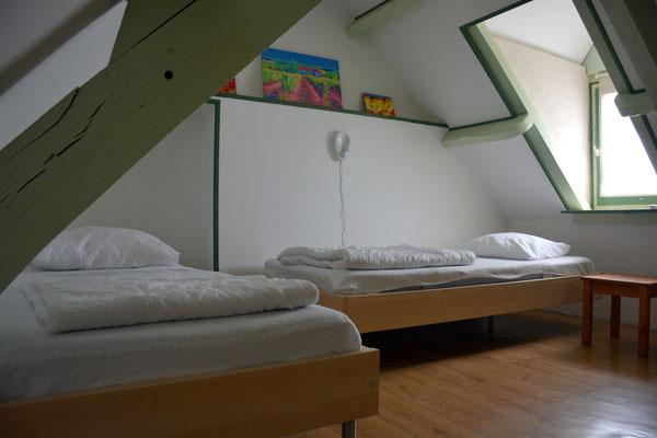 Tweede slaapkamer, een etage hoger.
