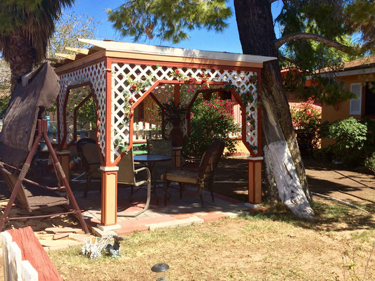 This house had a beautiful gazebo that was decorated with red roses.