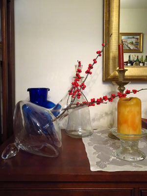 winter berries in wine carafe