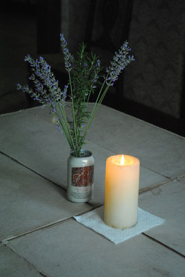 table decorations for company - homegrown lavender and rosemary, a good summer beer, and a candle we found under the sink