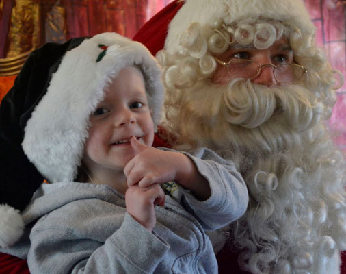 A happy child gets to talk to Santa