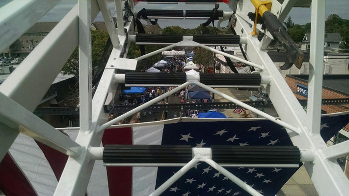 View between the rungs looking down at the crowd