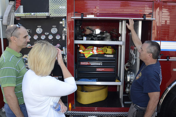 Assistant Fire Chief Dave Zawodniak giving Mayor Mahr and Reverend Jahnke a tour