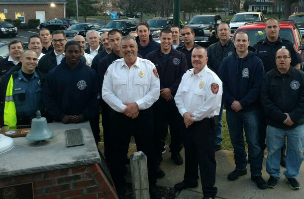 Members of Fanwood and Scotch Plains fire departments with Fanwood Chief Piccola in the center