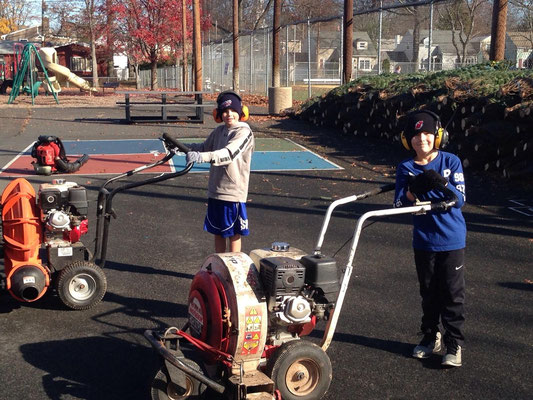 Next generation firefighters Brady DeProspero (left) and Dougie Germinder (right) help set up the park for tree sales.