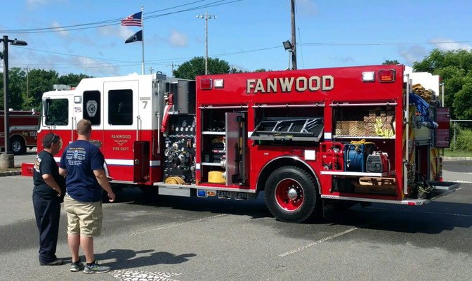 SP Fire officials while judging Fanwood's new Engine 7 as part of the Best Looking Rig competition