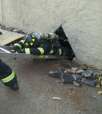 Removing a downed firefighter from a basement