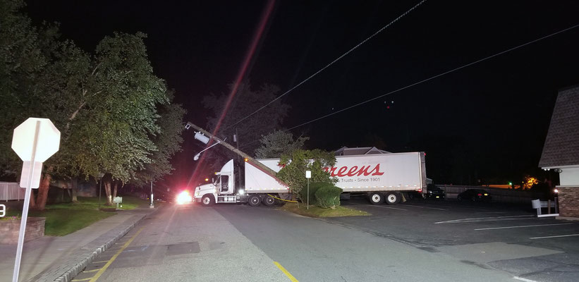 Pole and live wires down on 1st Street