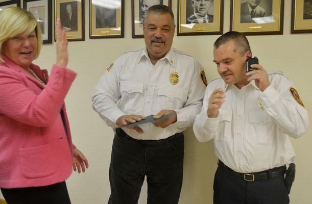 Mayor Mahr, Chief Piccola and Asst Chief Zawodniak as the dispatch to a call quickly ended the ceremony. (Photo courtesy of Tom Horton)