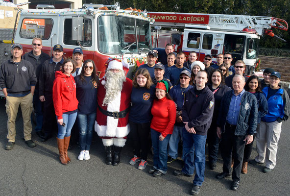 Santa with some of the many Emergency Services personnel, family members and friends who assisted with the annual Santa Run (photo courtesy of Brian Horton)