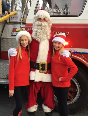 Santa with two very special helpers