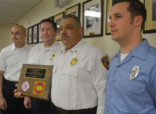 From left: SPFD officers Joe Rodrigues and Skip Paal, FFD Chief John Piccola  and SPFD firefighter Dennis Hercel