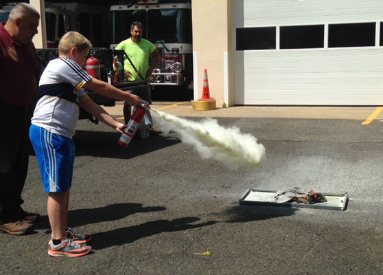 Putting out a fire with a dry chemical extinguisher