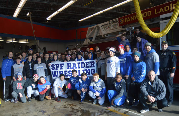 Members of the SPF Raiders Wrestling Team along with Coach Marc Fabiano (far left) and Police Officer and Firefighter Dan Piccola (kneeling far right)