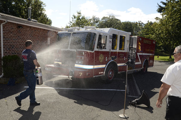 Scotch Plains Fire Chief John Lestarchick wetting down Engine 7