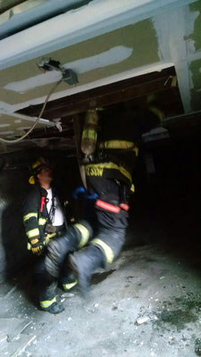 Rescuing a firefighter who fell through a floor
